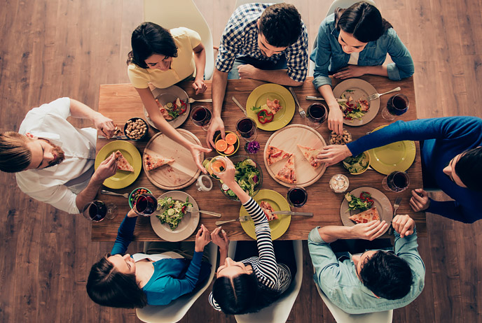 image of young people eating at table