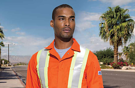 Image of Contruction worker wearing Flame Resistent bib overalls